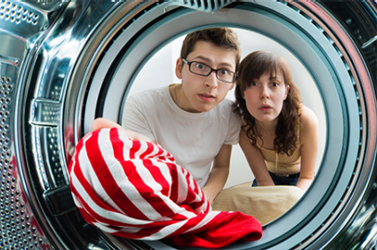 couple looking in washer needing appliance repair