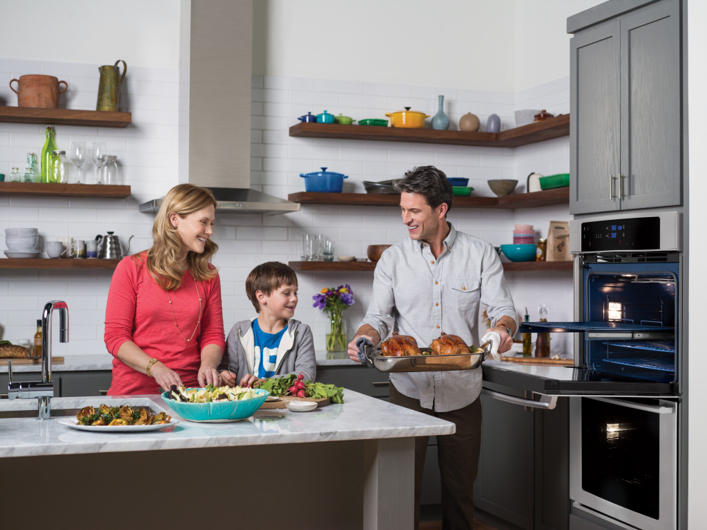 A Same Day Appliance Repair Family In A Kitchen With Oven